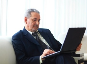 CEO sitting with laptop