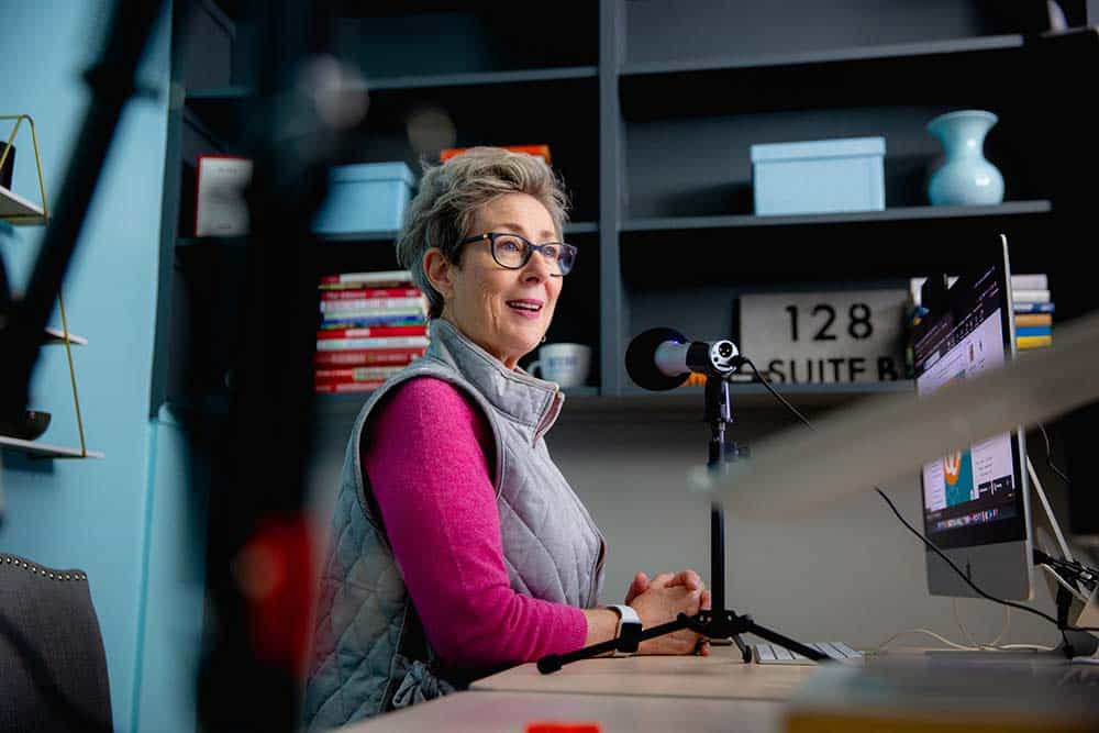 Colleen McKenna recording a podcast in the Intero Advisory studio